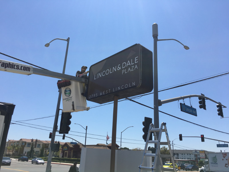 Install new pylon sign facings in Anaheim CA