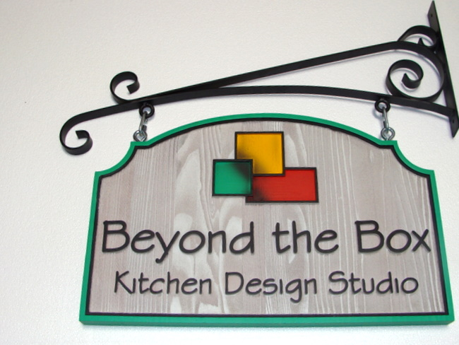 SA28405 - Carved Wood Sign for Kitchen Design Studio, Hung from Decorative Wrought Iron Scroll Bracket
