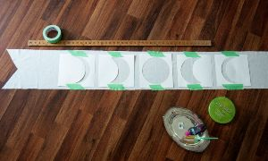 All phases of the moon stenciled on top of table runner fabric.