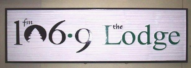 "SA28588 - Wood-Grain High Density Urethane Sign for Radio Station ""106.9 Lodge"""
