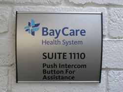 ADA Suite Sign