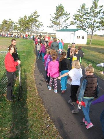 Area communities celebrate International Walk to School Day on amenities WCI helped plan