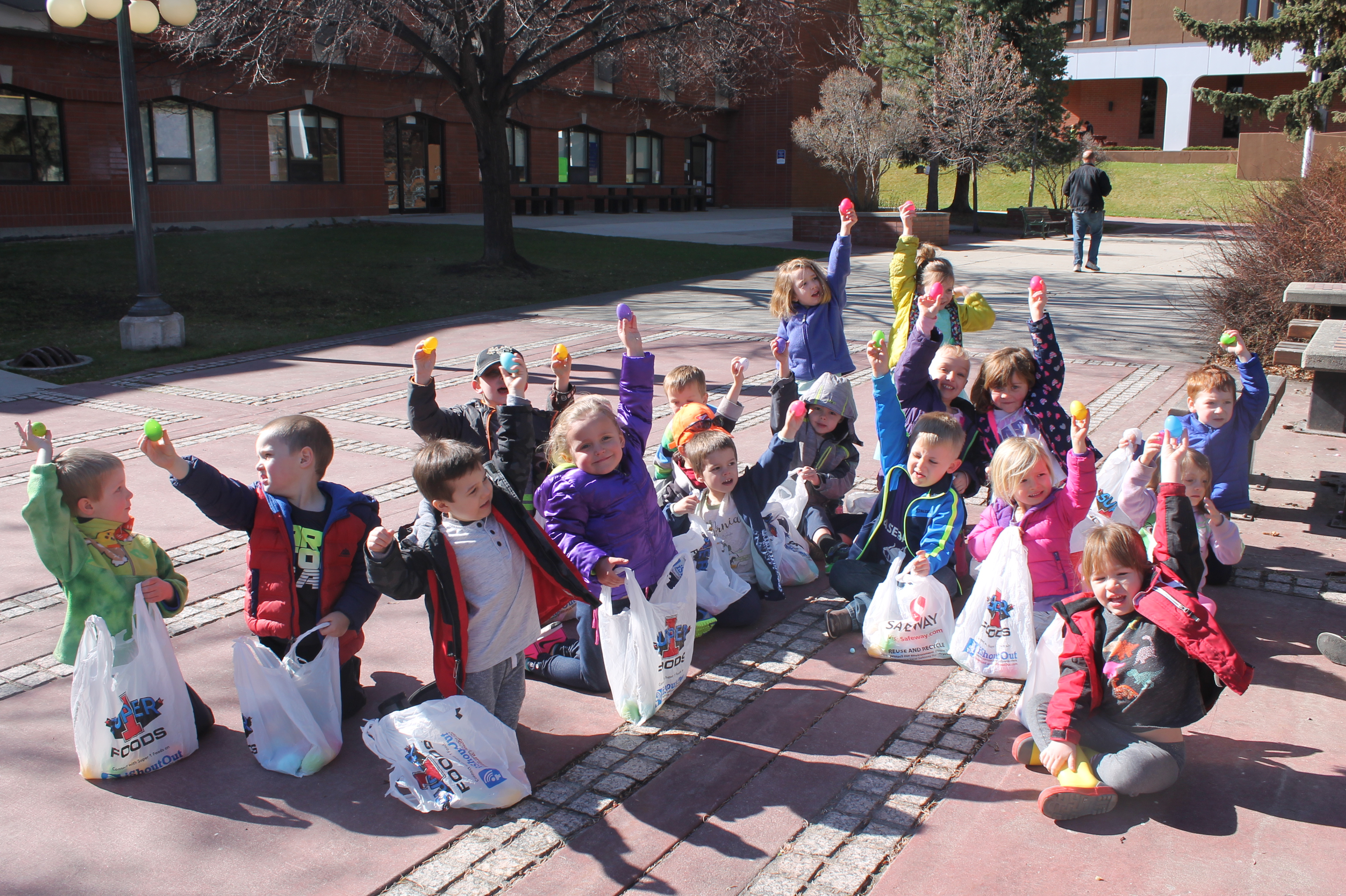 Pictured: RMPC kids holding up their eggs after a lengthy Easter Egg hunt in a local park.