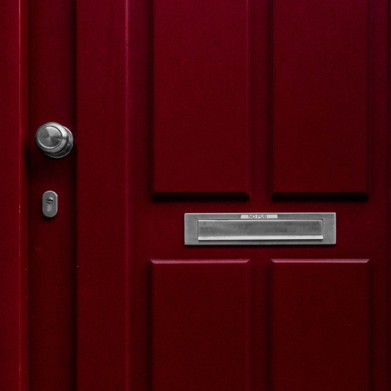 Front door with mail slot attached
