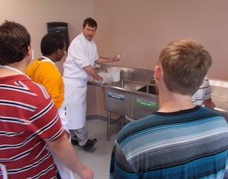 Chef Scott demonstrating kitchen safety measures