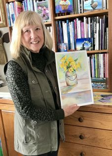 Artist Barb Ross with watercolor painting