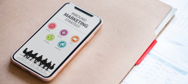 Cell phone displaying an inbound marketing strategy