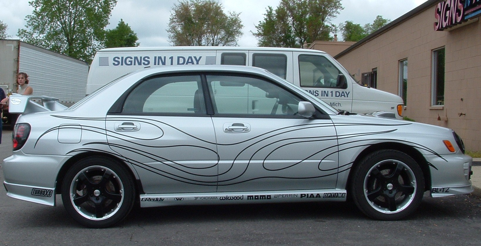 car graphics With custom auto lettering