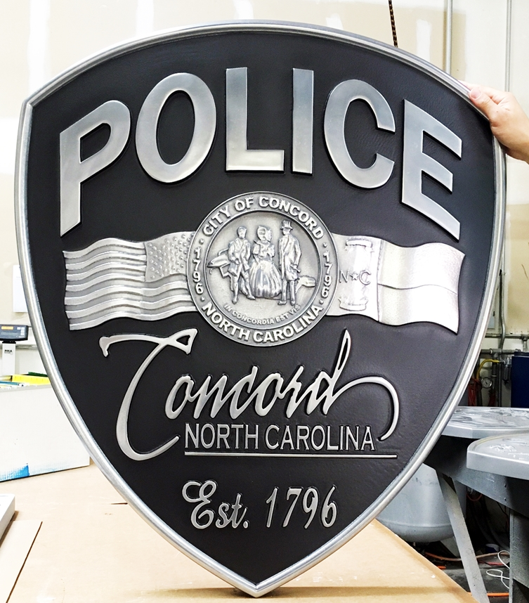 X33415 - 3-D Carved  Aluminum Metal-Coated Wall Plaque of the Shoulder Patch of the Police of Concord, NC