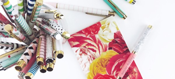 Colorful postcard and pens laying on a desk