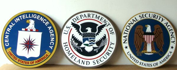 U30422 - Wall or Podium Plaques of the Seals for the CIA, Homeland Security, and NSA.