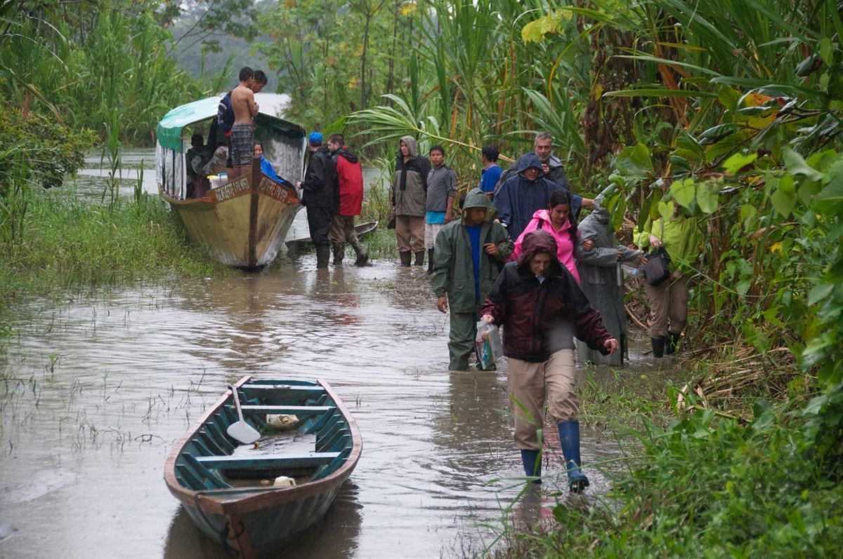 boat on a river with volunteers