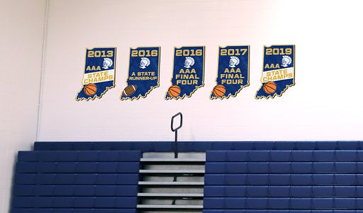 High school gym wall with state champ signs, state cut out signs, custom signs