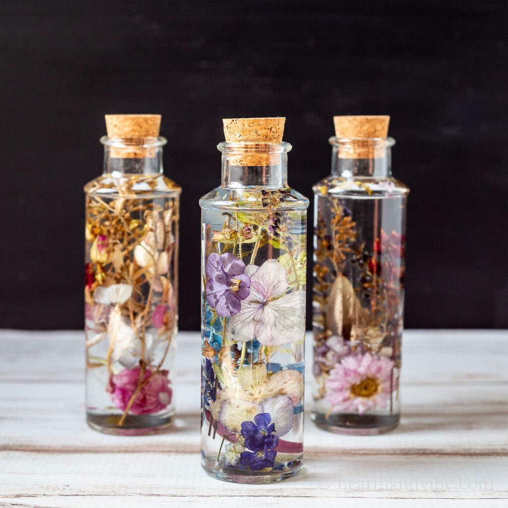 Photo of glass bottles with flowers inside. (Photo credit: Patti Estep of HearthandVine.com)