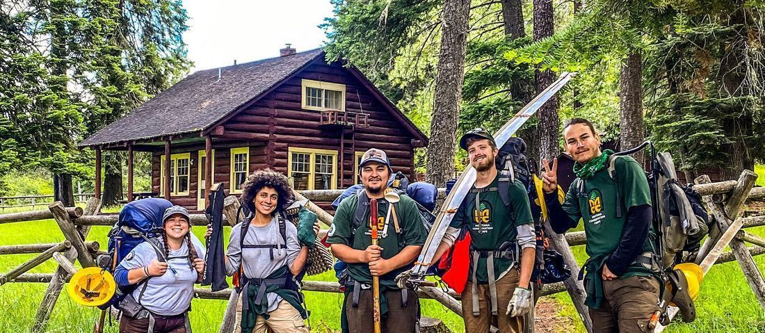 Crew at cabin doing adventure with purpose