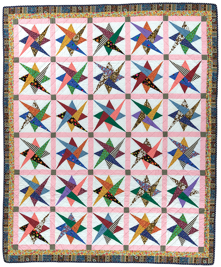"Interlocking Triangles, machine pieced and quilted by Ernest B. Haight, dated 1984, 90"" x 74"", IQSCM 2001.005.0001, NSQG Collection"