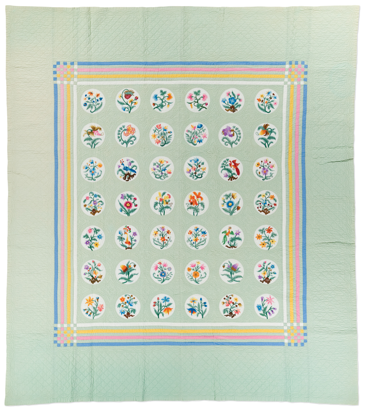 Embroidered quilt, made by Emily Grace Doane Meitzke, circa 1933-34, made in Loraine, Ohio, embroidered, hand pieced, hand quilted, 85 x 74.75 inches,  IQSCM 2010.044.0002, gift of Jane Ellen Meitzke MacDuff
