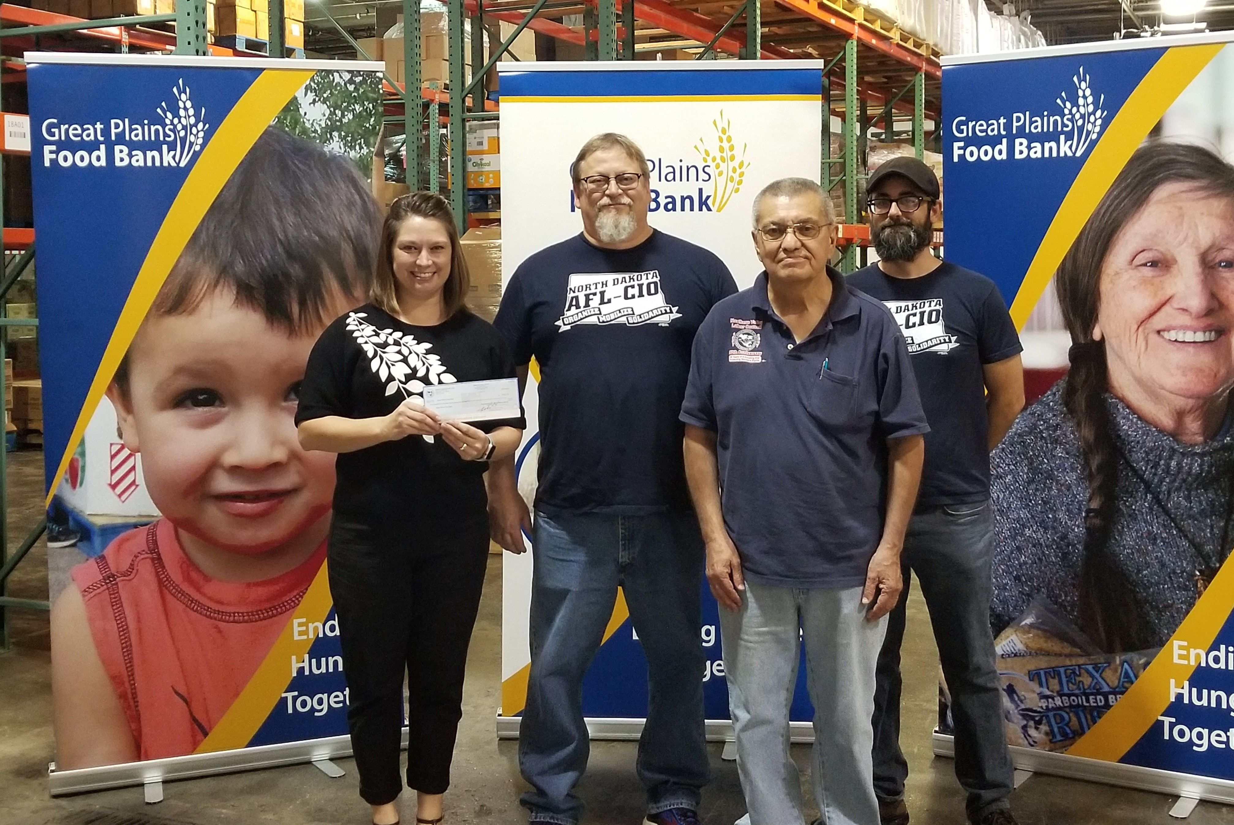 Union leaders deliver donation of more than $5,500 to Great Plains Food Bank