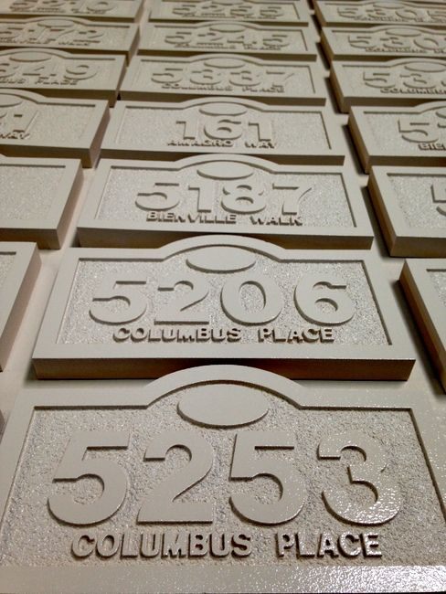 KA20940- Photo of Apartment Number Signs after Carving and Sandblasting, before Painting