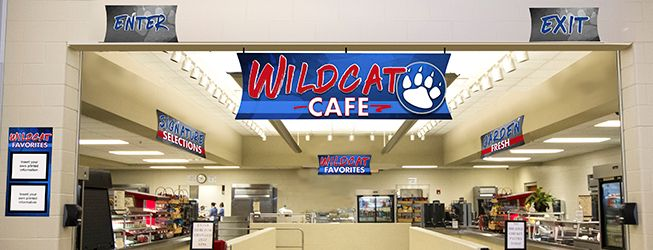 Custom school signs in a cafeteria entrance, school spirit signs with custom colors, menu board