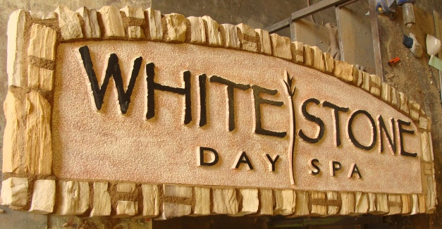 "S28193 - Monument Sign for ""Whitestone Day Spa"", with Rock Border and Arch"