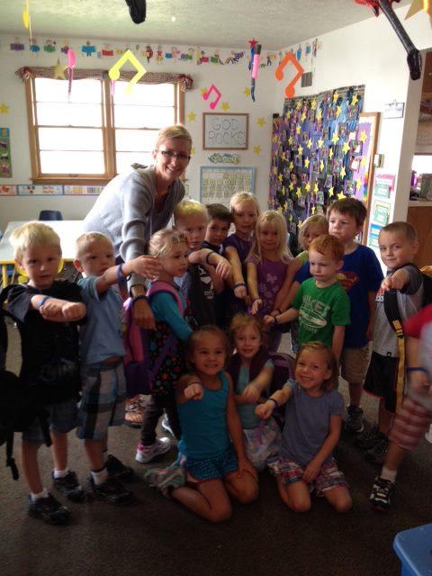 Sammy's (Would be) Preschool class & teacher sporting their superhero bracelets.