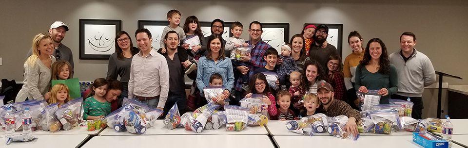 J-LEAD members and families volunteering in the JFS Food Pantry