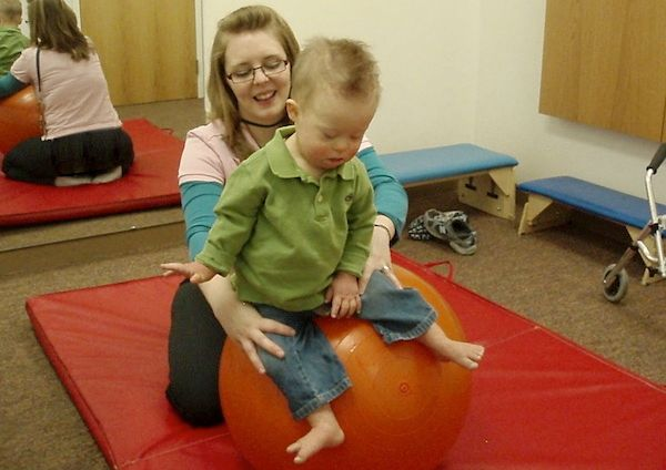 Toddler boy reports to physical therapy to gain key motor skills.