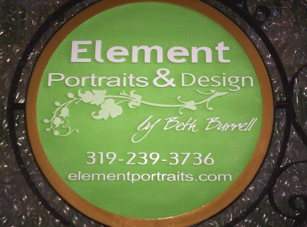 """SA28410A -  Carved HDU  Sign for the """"Elements Portrait & Design""""  Studio, with Round Iron Frame"""