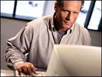 Man At Computer Looking For Information