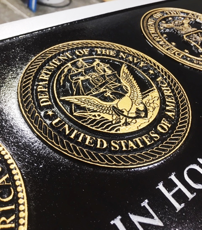 IP-1334- - Name Plaque Honoring  Servicemen from 1935-1975, with Six Military Seals (close-up of Navy Seal , side view showing Seal detail)