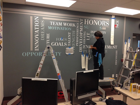 How are wall graphics installed in Orange County