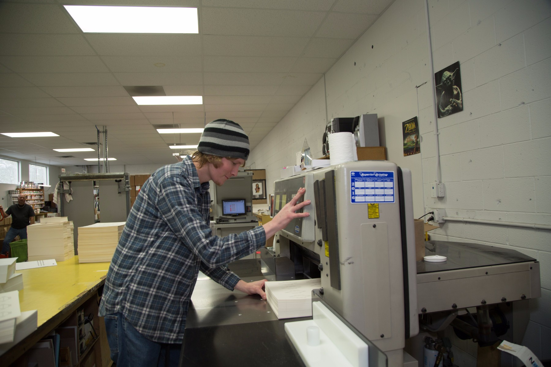 print shop worker applying finishing touches in salt lake city