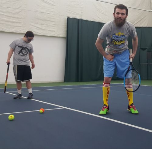 Young man with with disability playing tennis