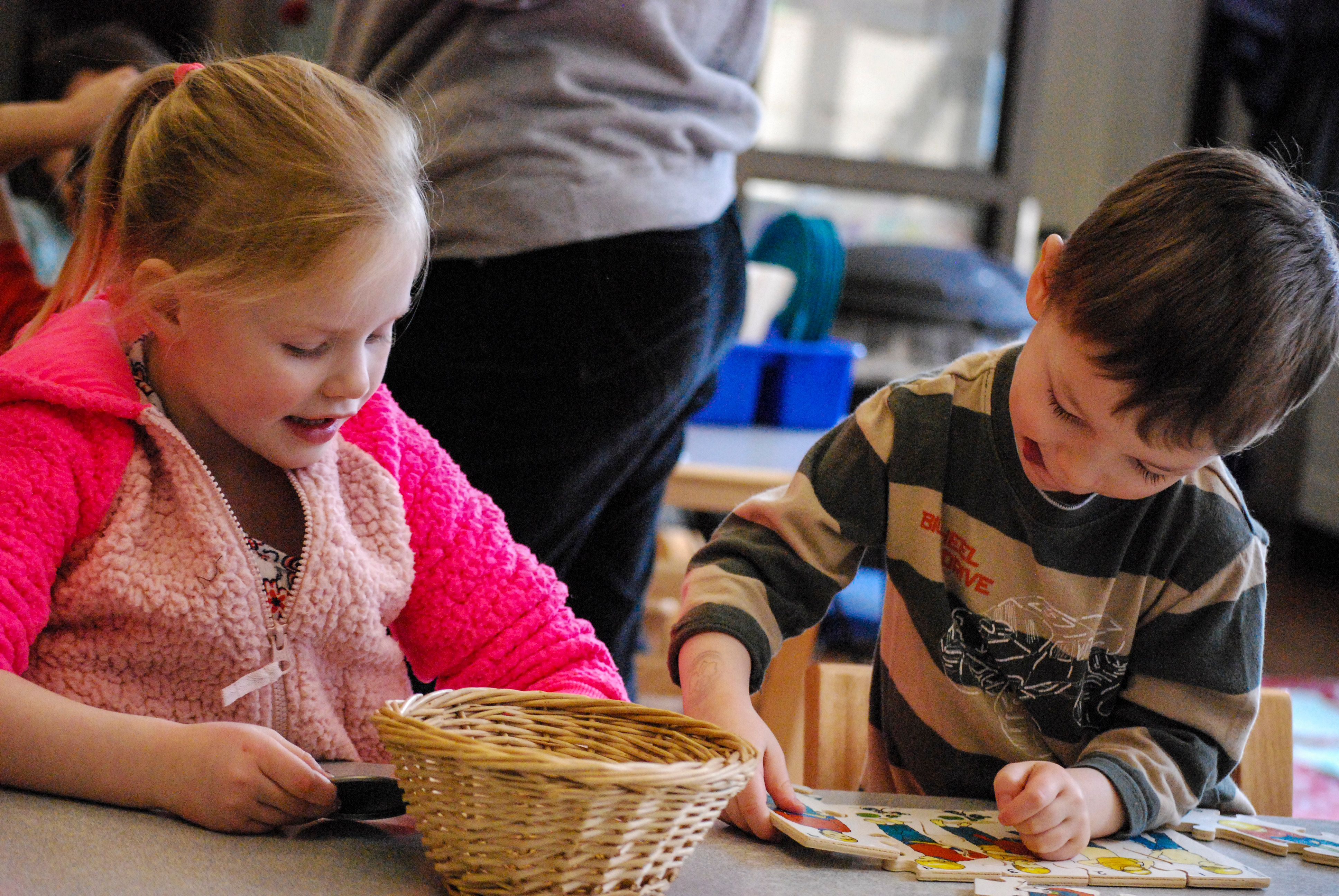 A young girl and boy work on a project together in one of Rocky's Head Start classrooms.