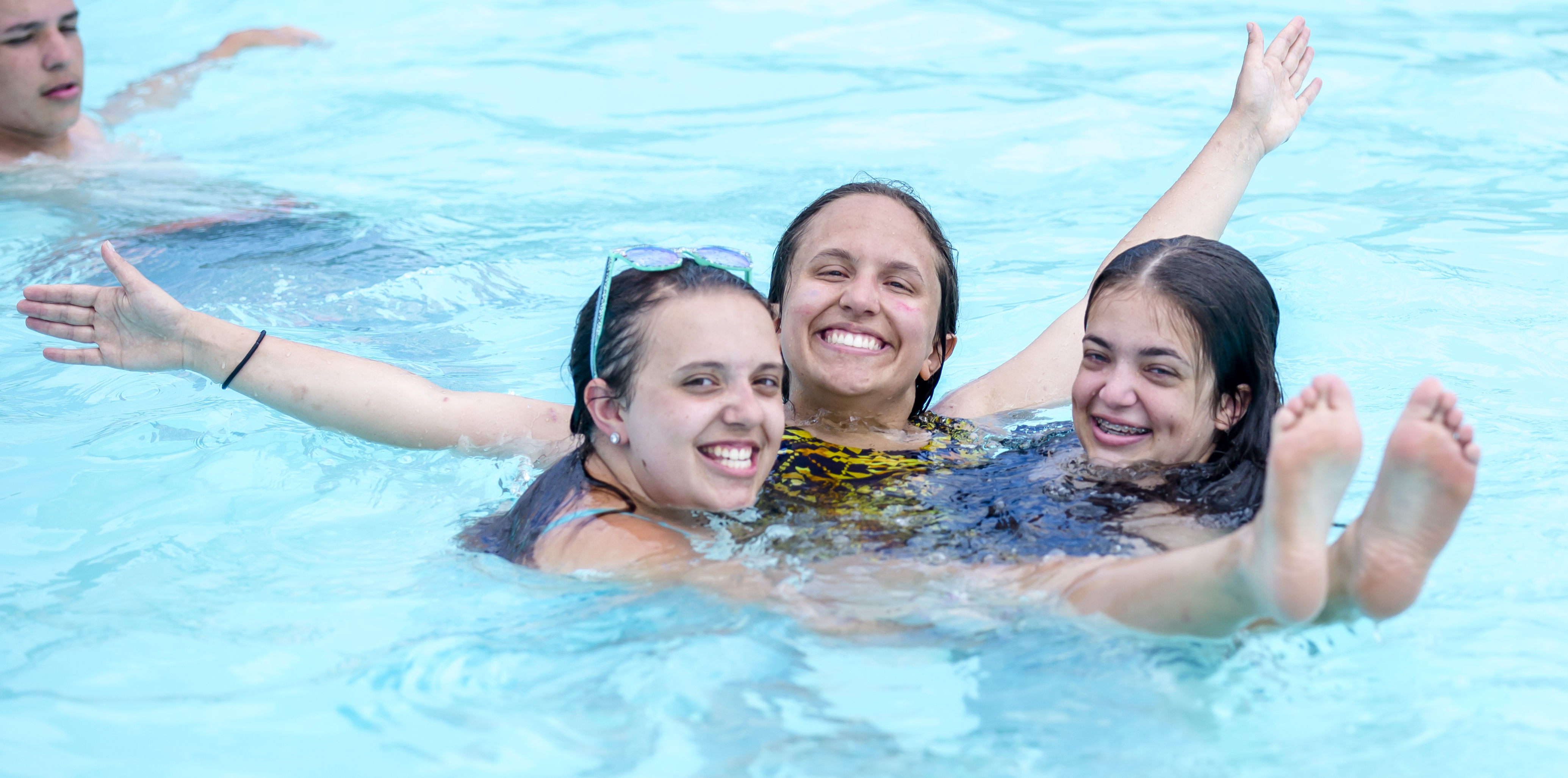 Campers enjoy the swimming pool.
