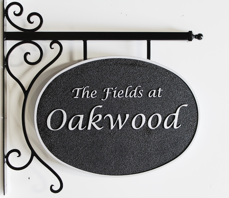 """I18101  -  Carved High-Density-Urethane (HDU) property name sign made for """"The Fields at Oakwood"""", with Custom Wrought Iron Scroll Bracket"""