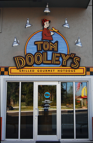 "Q25803 - Carved, Wood Look HDU Sign for Tom Dooley's Restaurant"" ""Grilled Gormet Hotdogs"""