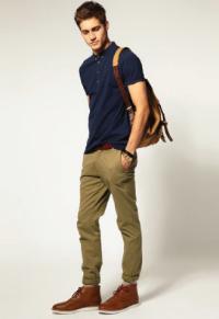 High school-aged male student dressed in a school uniform.