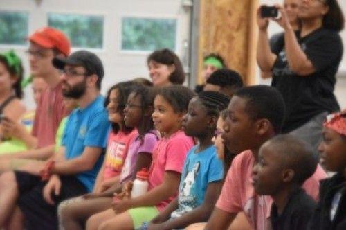 Children listen to a doctor's talk.
