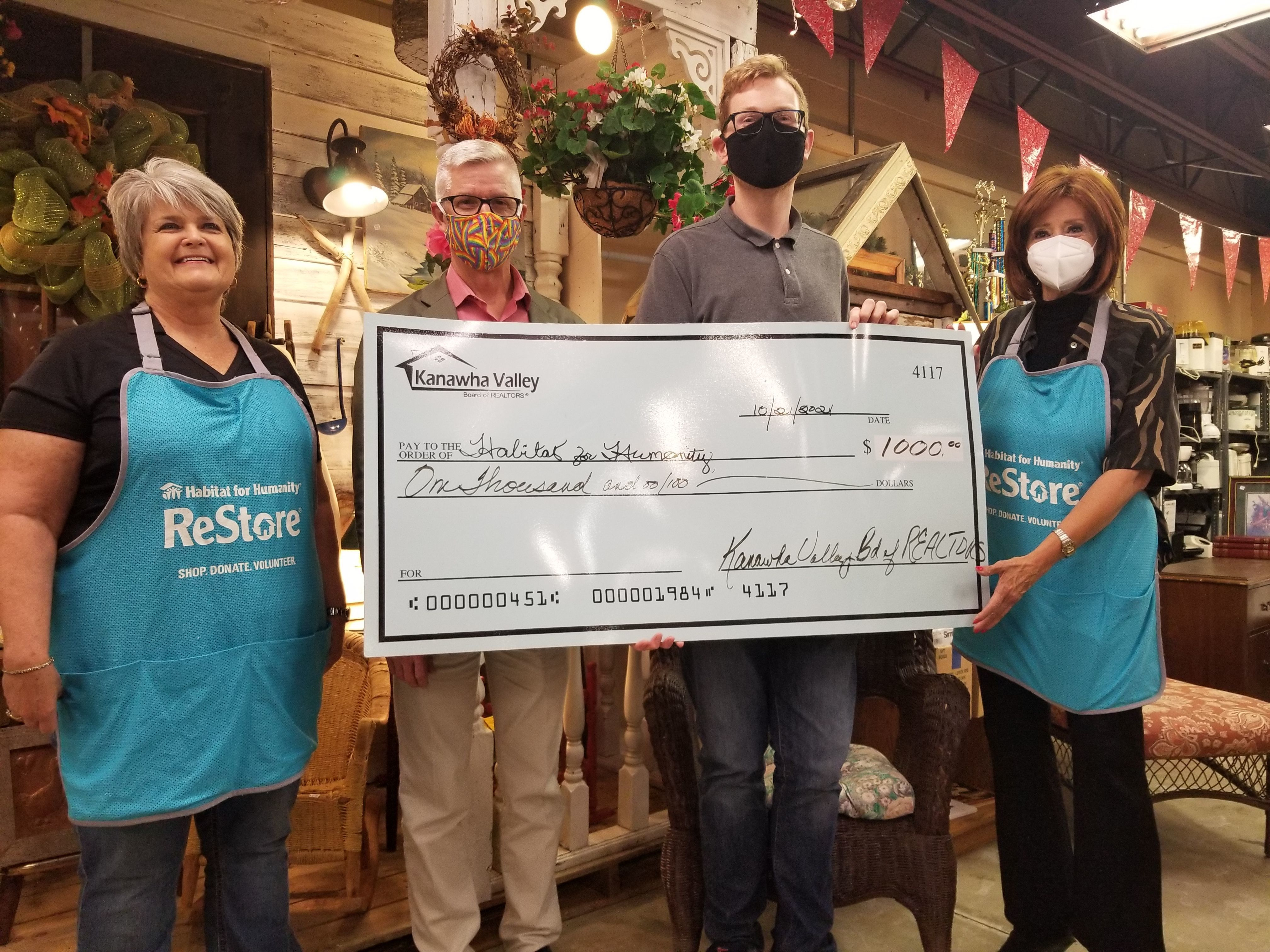 Kanawha Valley Board of Realtors Donates $1,000  and volunteer labor to Habitat