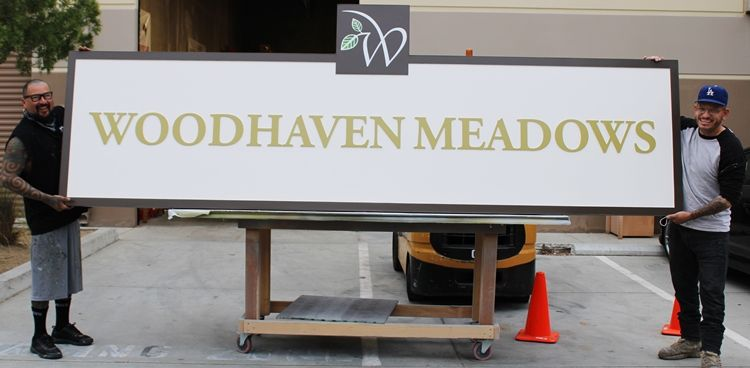 "K20166 - Carved High-Density-Urethane (HDU)  Entrance Sign for a Residential Community ""Woodhaven Meadows"", with Logo."