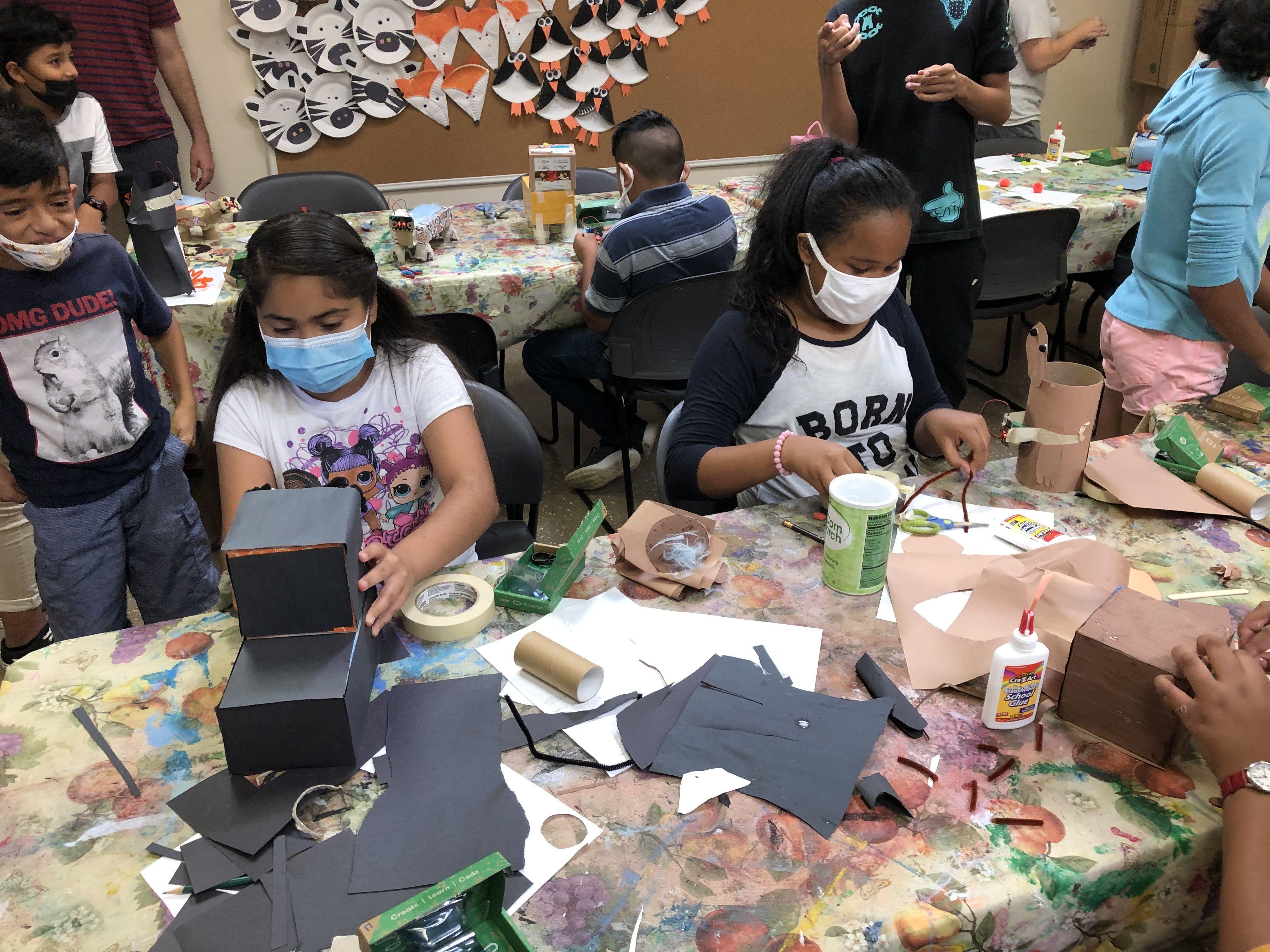 Children Building Robot Pets at Mooncrest STEM Camp