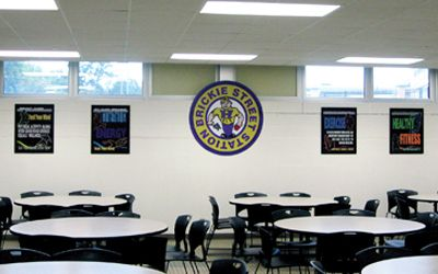 School café showing health and fitness posters, black, flip open frames, custom signs