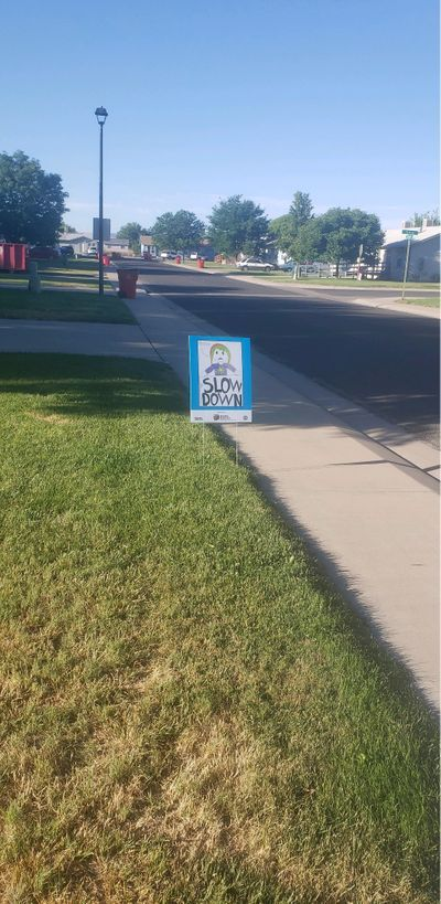 Posters are now street signs for the neighborhood.