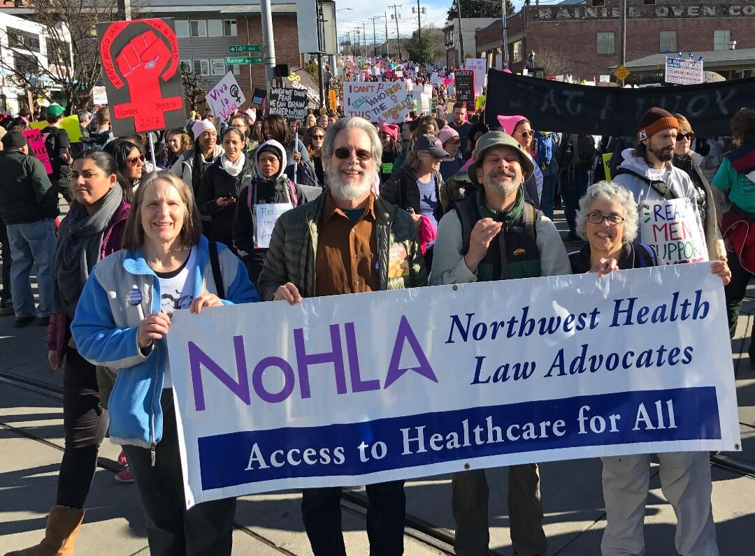 Janet at a rally, marching with the NoHLA banner.