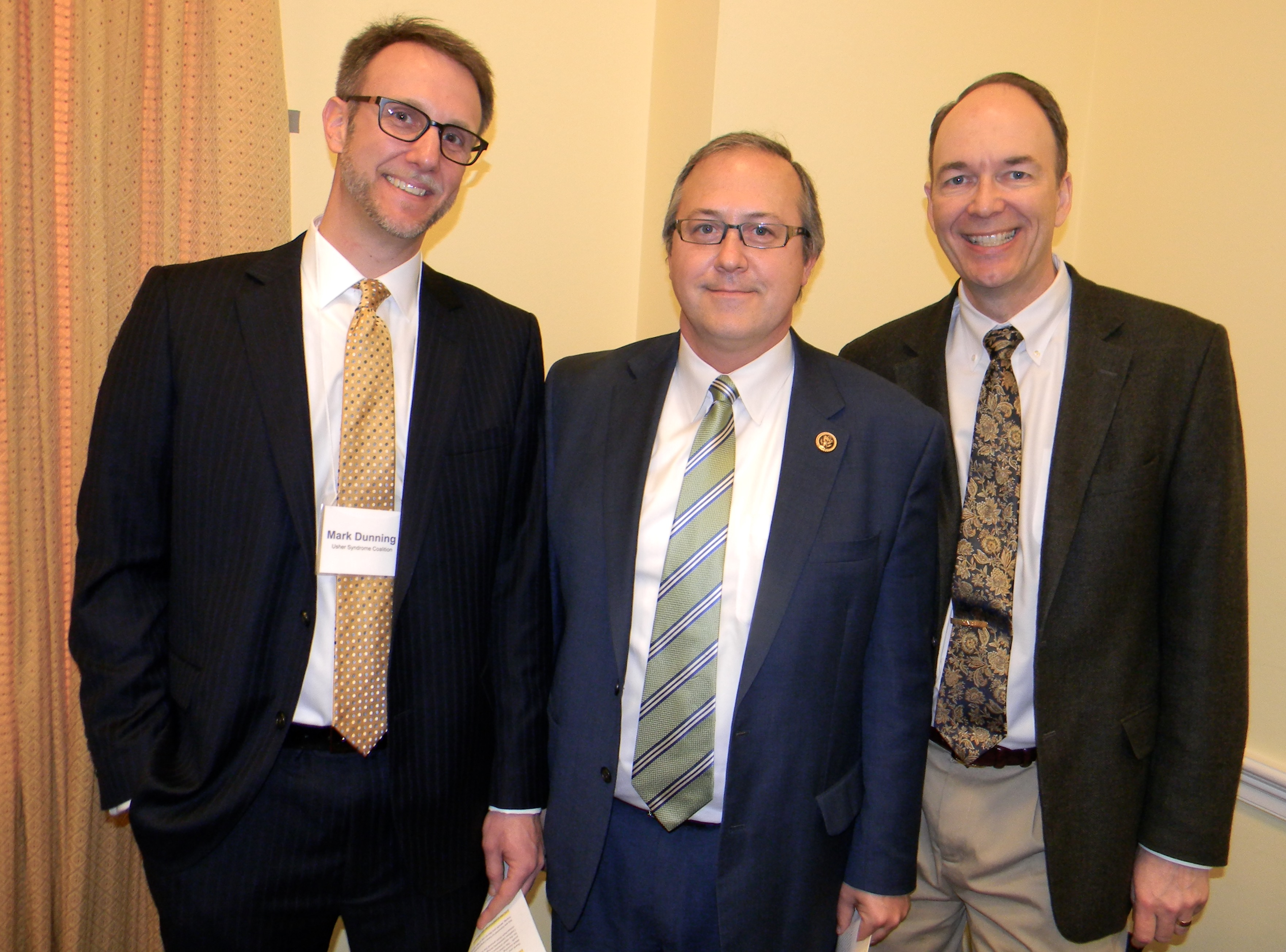 A picture of Mark Dunning, Congressman David Young, and Dr. Edwin Stone