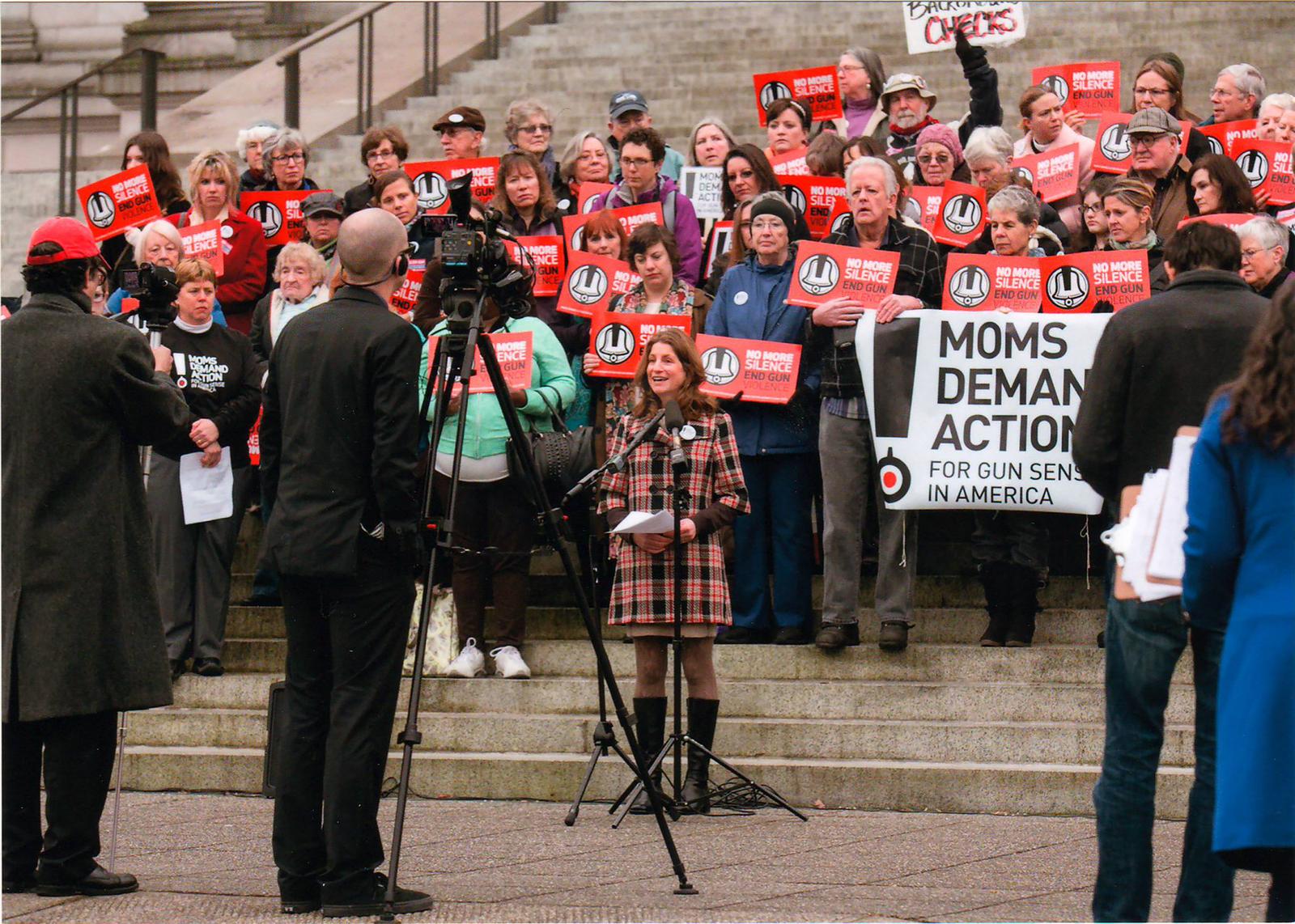 Tana speaking at a demonstration against gun violence.