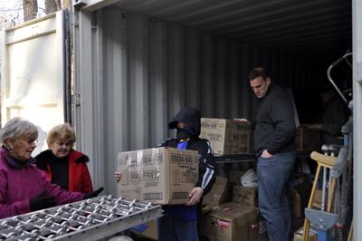 Volunteers loading shipment for Ghana, Africa