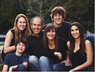 Photo of the Corderman family: Mother, father, two daughters, two sons
